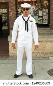 Dallas, Texas / USA - September 26, 2015: US Navy Soldier Standing on the Street Holding a Cigarette