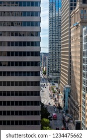 DALLAS, TEXAS/UNITED STATES- NOVEMBER 9, 2018: A street view of modern downtown Dallas high rise buildings and their reflections looking towards the former Texas School Book Depository Building