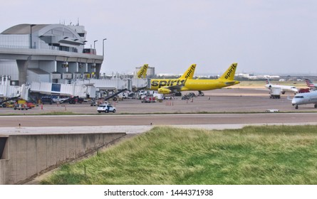 Dallas, Tex./USA-July 6, 2019: Airplanes operated by Spirit Airlines parked at DFW International Airport's Terminal E.