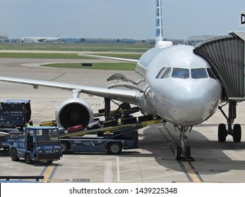 Dallas, Tex./USA-June 30, 2019: Workers unload an American Airlines aircraft after its arrival at Dallas-Fort Worth International Airport's international terminal.