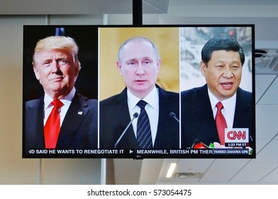 DALLAS, TX -23 JAN 2017- A television split screen showing American President Donald Trump, Russian President Vladimir Putin and Chinese President Xi Jinping on CNN on the same image.
