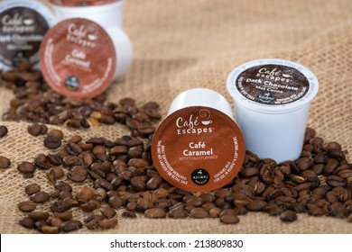 DALLAS, TX - JULY 30, 2014: Keurig Green Mountain Coffee single-serve K-Cups and coffee beans. Cafe Escapes is a collection of premium hot cocoas and dairy-based beverages available for Keurig brewer.