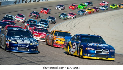 DALLAS, TX - NOVEMBER 04: Brad Keselowski 2 and Jimmie Johnson 48 lead the field at the Nascar Sprint Cup AAA Texas 500 at Texas Motorspeedway in Dallas, TX on November 04, 2012