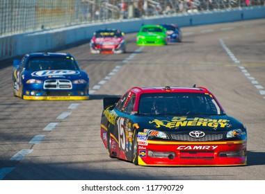 DALLAS, TX - NOVEMBER 04:  Clint Bowyer 15 leads Brad Keselowski at the Nascar Sprint Cup AAA Texas 500 at Texas Motorspeedway in Dallas, TX on November 04, 2012