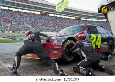 DALLAS, TX - NOVEMBER 04: Jeff Gordon tire change during at pit stop at the Nascar Sprint Cup AAA Texas 500 at Texas Motorspeedway in Dallas, TX on November 04, 2012