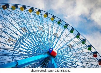 DALLAS, TX - October 17, 2019: Texas Star, the largest ferris wheel in North America, rises above the horizon at Fair Park in Dallas, Texas.