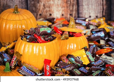 DALLAS, TX - OCTOBER 31, 2015: Decorative pumpkins filled with assorted Halloween chocolate candy made by Mars, Incorporated and the Hershey Company.