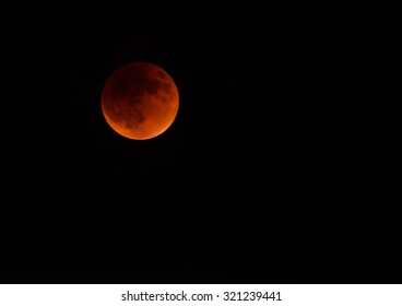 DALLAS, TX - September 27, 2015: A total supermoon lunar eclipse, also known as a blood moon, in Texas sky. A rare supermoon combines with a lunar eclipse for the first time since 1982.