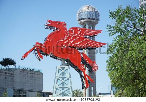 Dallas, TX / USA -3/30/2018 - Pegasus is shown with Reunion Tower and part of the Omni Hotel in the background.