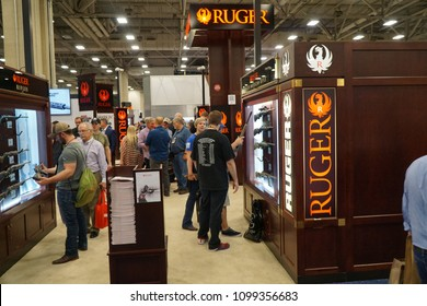 Dallas, TX / USA - 5/4/2018: Attendees at the 147th NRA annual meeting held at the Kay Bailey Hutchisons convention center examine the offerings of Ruger Firearms.
