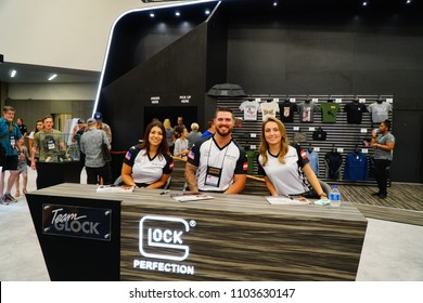 Dallas, TX / USA - 5/4/2018: Team Glock poses for a photo on the exhibit floor of the 147th NRA annual meeting held at the Kay Bailey Hutchisons convention center.
