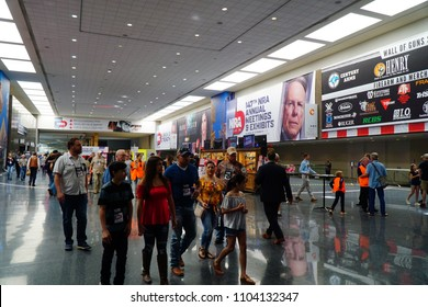 Dallas, TX / USA - 5/6/2018: A family walks the floor at the 147th NRA annual meeting held at the Kay Bailey Hutchisons convention center.
