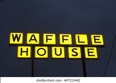 DALLAS, Tx, USA - APR 17, 2016: Waffle House fast food restaurant logo illuminated at night. Dallas, Texas, United States
