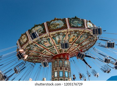 Dallas TX USA Oct 11, 2018: Children and adults enjoying an aerial chair ride at the Texas State Fair, running annually during the first three weeks of October at Fair Park in Dallas TX