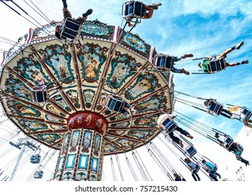 Dallas TX USA Oct 17, 2015: Children and adults enjoying an aerial chair ride at the Texas State Fair, running annually during the first three weeks of October at Fair Park in Dallas TX