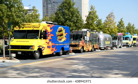 Dallas, TX USA  Oct  23, 2014: Food trucks are a very popular alternative lunch choice to office workers and park visitors at Klyde-Warren park. Trucks are shown in their reserved parking area.