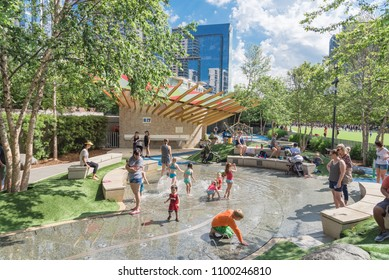 DALLAS, TX, USA-MAY 26, 2018:Water fountain, splash pad at children area in Klyde Warren Park. 5.2-acre public place in downtown Dallas. Surrounded by artificial turf berms, concrete seating, boulders