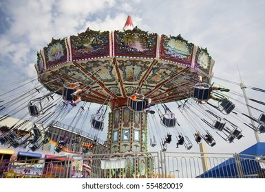 Dallas, TX USA/November 13, 2016: A spinning, tilting aerial swing ride at the State Fair of Texas, running annually at Fair Park during the first three weeks of October.