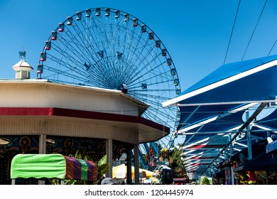 Dallas, TX USA/October 11, 2018:  Midway, carousel and the Texas Star at the State Fair of Texas, running during the first three weeks of October at Fair Park in Dallas, TX