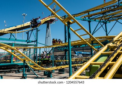 Dallas, TX USA/October 11, 2018:The steel superstructure and rails of a mini roller coaster at the State Fair of Texas, running annually during the first three weeks of October at Fair Park in Dallas