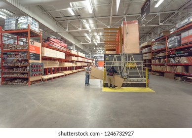 DALLAS, TX, US-DEC 1, 2018: Home Depot employee helping customer cutting wood near lumber yard. American home improvement supplies retailing company sells tools, construction products, services