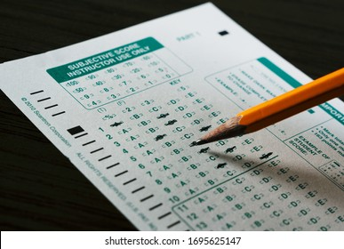 Dallas, TX/USA Feb 2020: Scantron sheet with filled in answers and a pencil. Answer sheet for school exams and tests