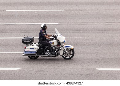 DALLAS, USA - APR 8, 2016: Motorcycle policeman from Dallas Police Department driving on the highway. Texas, United States