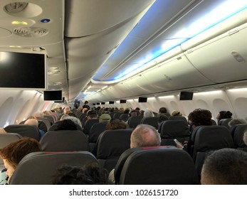 DALLAS, USA - FEB 14, 2018: DFW international Airport , airplane interior, passengers seating inside plane before take off.
