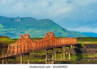 The Dalles Bridge seen and photographed from car traveling on I-84 through the Columbia Rver Gorge in Oregon.  Washington State is on the other end of the bridge that crosses the Columbia River