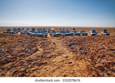 Dallol, Ethiopia - January 03, 2019: Group of white cars in the desert in Dallol, Ethiopia.