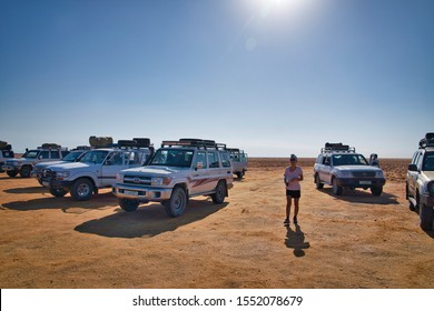 Dallol, Ethiopia - January 03, 2019: Tourist among cars in the desert on a hot day, in Dallol, Ethiopia.