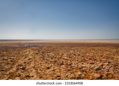 Dallol, Ethiopia - January 03, 2019: Group of white cars  waiting for the tourists in the desert in Dallol, Ethiopia.