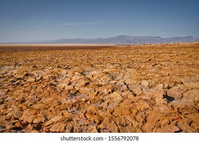 Dallol, Ethiopia - January 03, 2019: Empty brown dry desert on a hot day in Dallol, Ethiopia.
