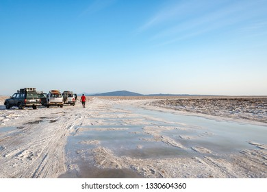 Dallol saline land/Ethiopia-02/02/2019: All terrain vehicles on saline land and man walks toward on them