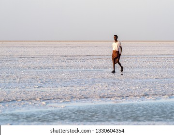 Dallol salt pan/Ethiopia -02/02/2019: Man from afar tribe walks on the salt pan