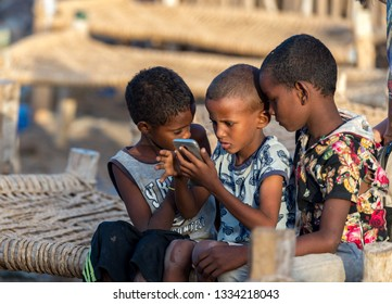 Dallol/Ethioia-02/03/2019:Kids from afar tribe playing with the smartphone