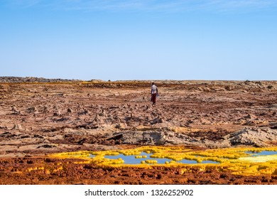 Dallol/Ethiopia -02/02/2019: Man from afar tribe walks on Dallol volcano