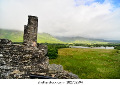 DALMALLY, SCOTLAND- 18 JULY 2013: A scene from Kilchurn Castle, a 14th century ruin at the head of Loch Awe, in Argyll and Bute, Scotland. It used to an be original powerbase of Clan Campbell.