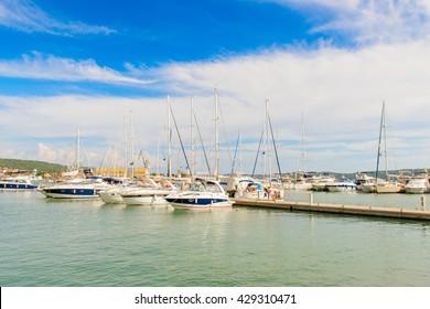DALMATIA, CROATIA - AUG 24, 2014: Boats near the Coast of Croatia, on the Adriatic Sea. Catchment areaof the Adriatic Sea is 235,000 km2 (91,000 sq mi)