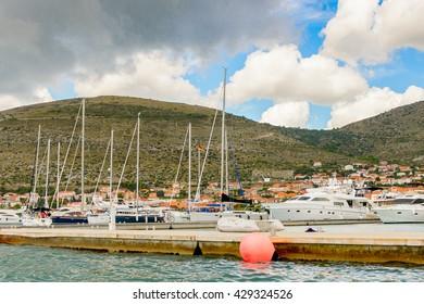 DALMATIA, CROATIA - AUG 24, 2014: Yachts of the Seget Yacht Club near the Coast of Croatia, on the Adriatic Sea. Catchment areaof the Adriatic Sea is 235,000 km2 (91,000 sq mi)