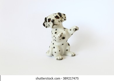 Dalmatian dog ceramic figurine isolated on white