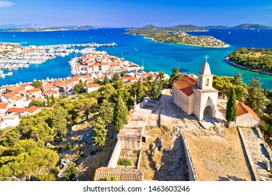 Dalmatian town of Tribunj church on hill and amazing turquoise archipelago aerial view, Dalmatia region of Croatia