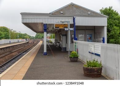 Dalmeny, Scotland - May 24, 2018: Rural railway station with platform and ticket office near Queensferry and Edinburgh, Scotland