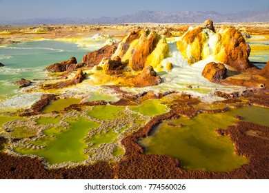 Dalol Danakil Depression, Northern Ethiopia. Volcanic hot springs. Earths lowest land volcano. It is dangerous places to visit. Surface is  covered by a crust  with pools of hot acid water below.