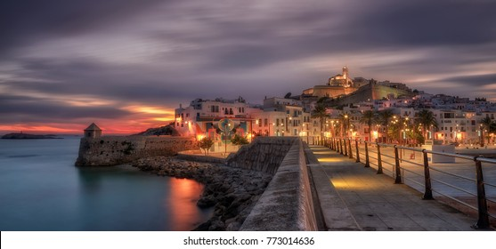 Dalt vila old town at sunset , blue hour  viewed from Ibiza harbour .