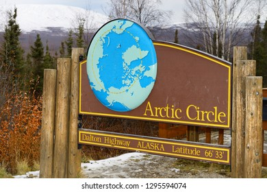 Dalton Highway, Alaska, United States - October 13, 2013: Sign board for the Arctic Circle along the Dalton Highway in Alaska