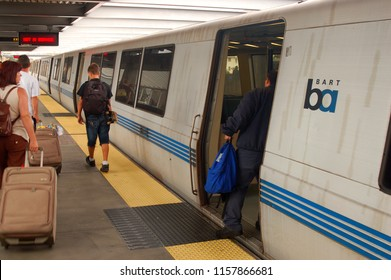 Daly City, CA, USA July 31, 2007 Commuters board and depart a BART Train in Daly City, California and heading towards San Francisco