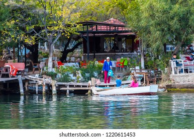 Dalyan, Greece - October 31, 2018 : People are rowing boat at Riverside in Dalyan Town of Turkey