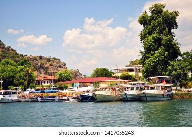 Dalyan, Mugla,Turkey-06.05.2017: Boat trip in Turkey. Dalyan canal view. Fishing boats on the marina between River Dalyan and famous Iztuzu Beach.