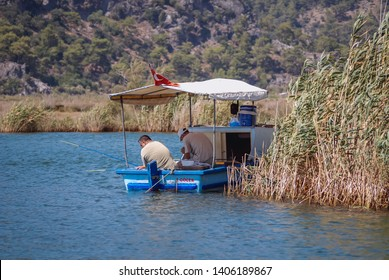 Dalyan, Turkey - August 26, 2007: Fishing boat on the River Dalyan near Dalyan town in Mugla Province